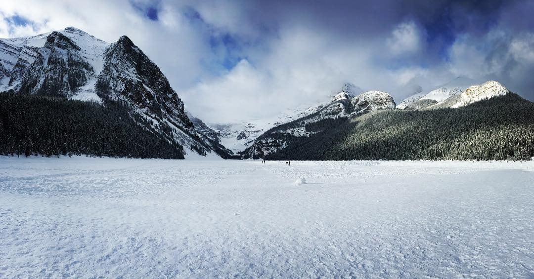 Standing on the frozen Lake Louise, taking a picture of Lake Louise.